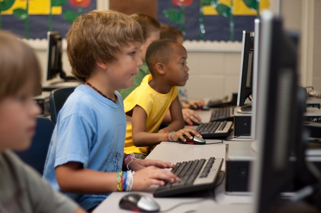 Image of students using computer from https://pixabay.com/en/students-computer-young-boy-99506/